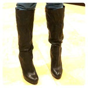 MICHAEL Michael Kors black leather heeled boots.